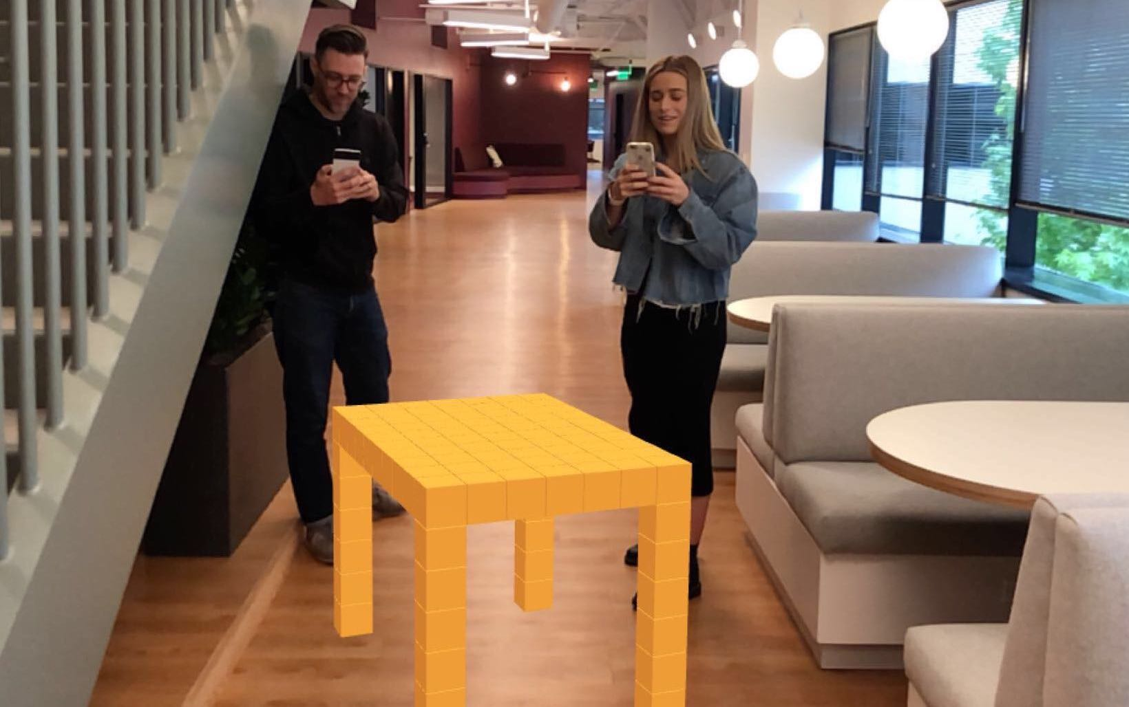 Two Blocks users are collaboratively creating a table in augmented reality.
